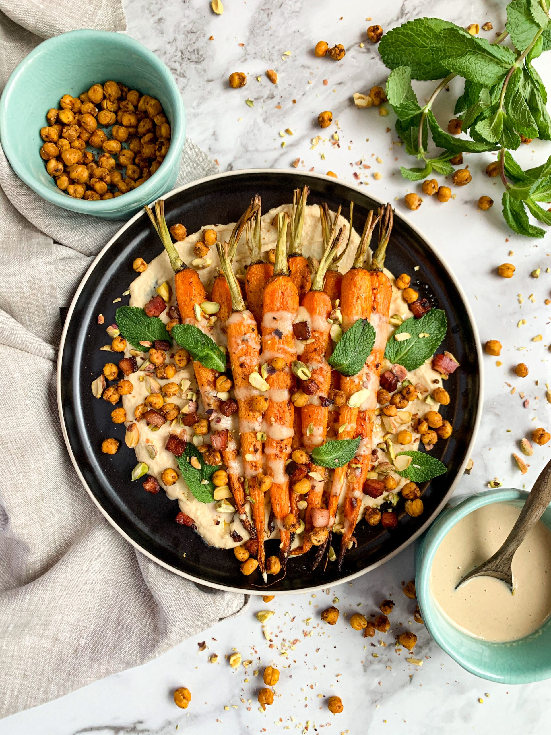 Roasted Carrots over a bed of hummus and crispy chickpeas