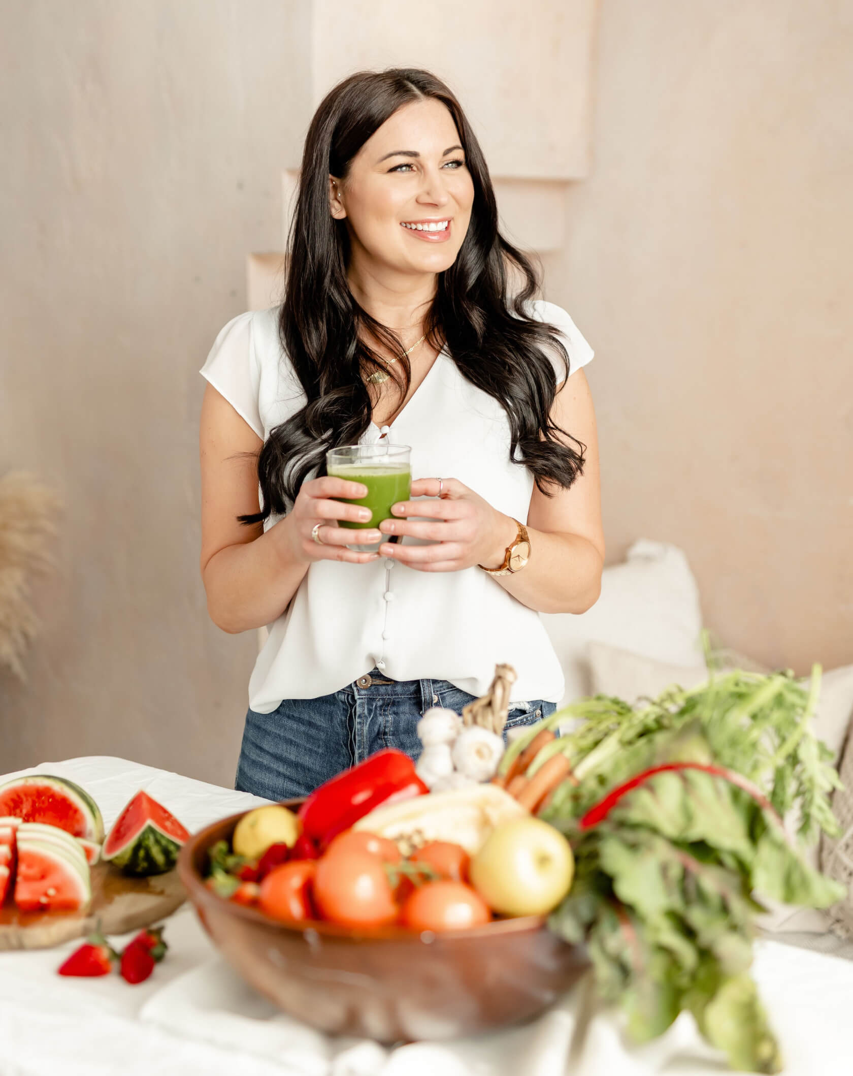 Rachelle is a food blogger holding a green smoothie