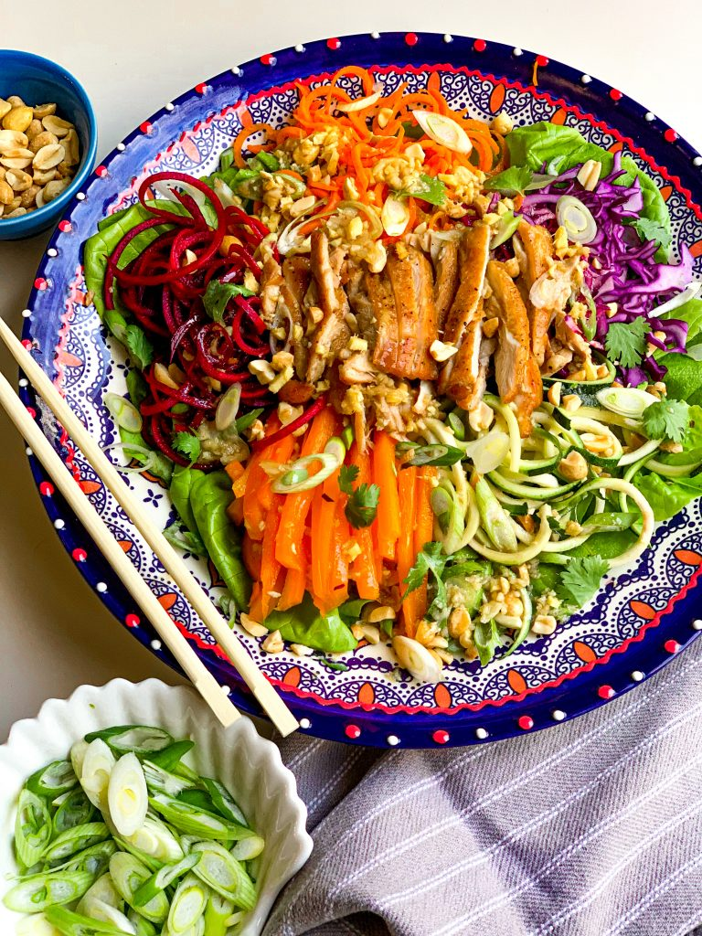 Healthy Chinese Chicken salad with bright vegetables and a peanut dressing